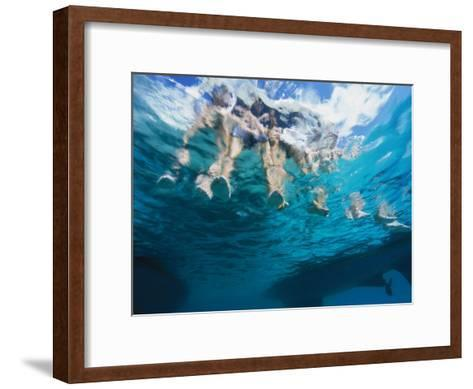 Boaters Dangle Their Feet in the Caribbean Sea-Heather Perry-Framed Art Print
