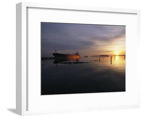Twilight View of a Ship at Anchor in Still Water at Low Tide-Bill Curtsinger-Framed Art Print