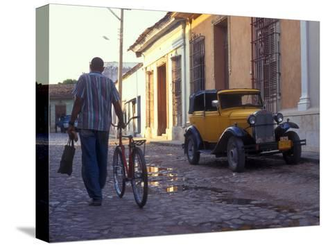 A Man Walks Down the Cobblestoned Street of This Tropical Island, Trinidad, Cuba-Taylor S^ Kennedy-Stretched Canvas Print