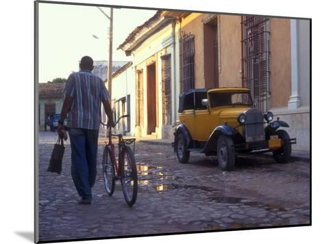 A Man Walks Down the Cobblestoned Street of This Tropical Island, Trinidad, Cuba-Taylor S^ Kennedy-Mounted Photographic Print