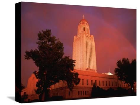 A Rainbow Shines Over the Nebraska State Capitol after a Storm-Joel Sartore-Stretched Canvas Print