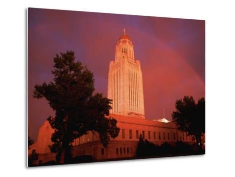 A Rainbow Shines Over the Nebraska State Capitol after a Storm-Joel Sartore-Metal Print