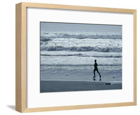 A Person Jogs Along the Beach-David Boyer-Framed Art Print