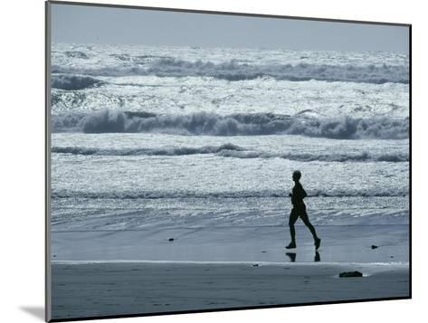 A Person Jogs Along the Beach-David Boyer-Mounted Photographic Print