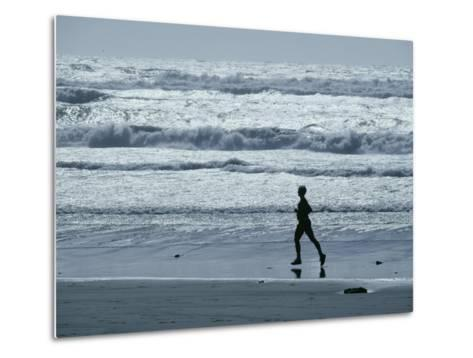 A Person Jogs Along the Beach-David Boyer-Metal Print