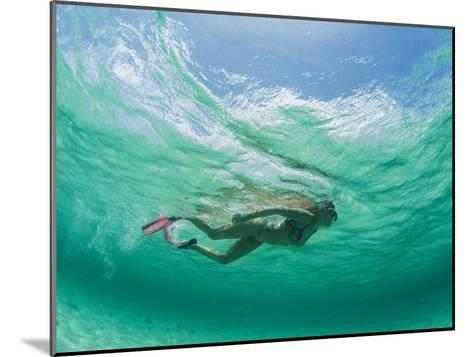 A Woman Snorkels under the Waves-Barry Tessman-Mounted Photographic Print