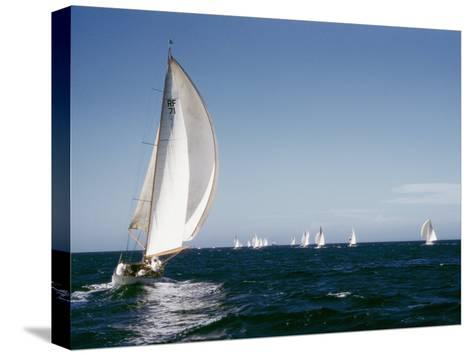 A 35-Foot Sailing Sloop is Seen from Behind-W^ Robert Moore-Stretched Canvas Print