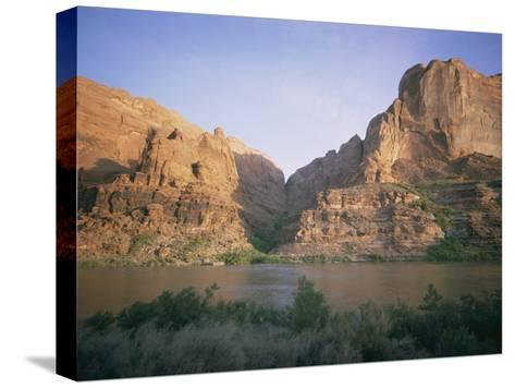 The Colorado River Flows Past Hole-In-The-Rock-Walter Meayers Edwards-Stretched Canvas Print