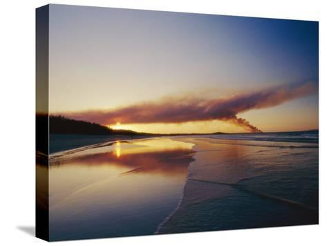 Smoke from a Brushfire Forms a Large Cloud over a Shoreline Bathed in Low Sunlight-Jason Edwards-Stretched Canvas Print