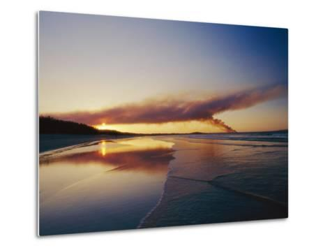 Smoke from a Brushfire Forms a Large Cloud over a Shoreline Bathed in Low Sunlight-Jason Edwards-Metal Print