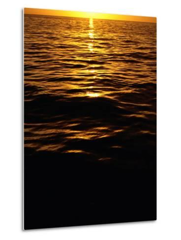 The Setting Sun Reflects onto the Waves-Heather Perry-Metal Print