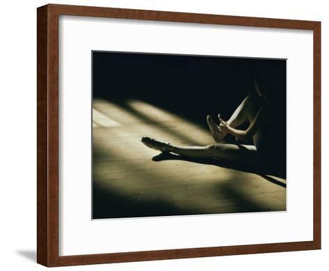 A Dance Student Adjusts a Toe Shoe-Robert Madden-Framed Art Print