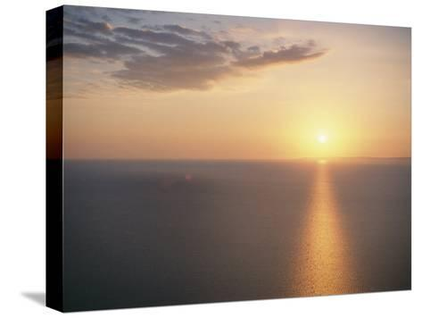 The Sun Sets over Lake Superior-Raymond Gehman-Stretched Canvas Print
