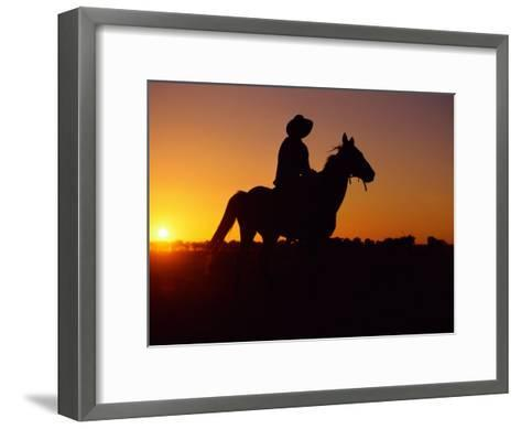 A Cowboy and His Horse Ride off in to the Sunset-Medford Taylor-Framed Art Print