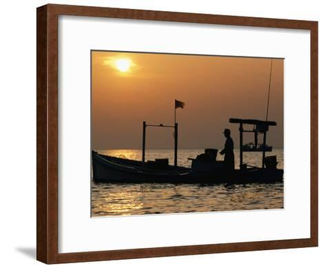 A Silhouetted Boat Fishing for Soft Crabs-Robert Madden-Framed Art Print