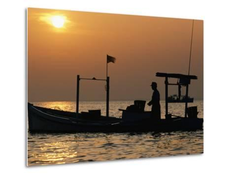 A Silhouetted Boat Fishing for Soft Crabs-Robert Madden-Metal Print