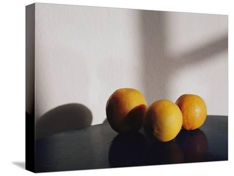 Still Life of Three Oranges on a Table-Todd Gipstein-Stretched Canvas Print