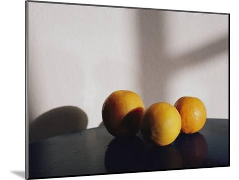 Still Life of Three Oranges on a Table-Todd Gipstein-Mounted Photographic Print