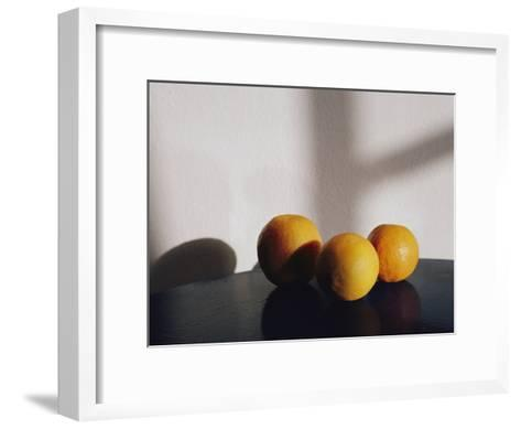 Still Life of Three Oranges on a Table-Todd Gipstein-Framed Art Print