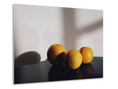 Still Life of Three Oranges on a Table-Todd Gipstein-Metal Print