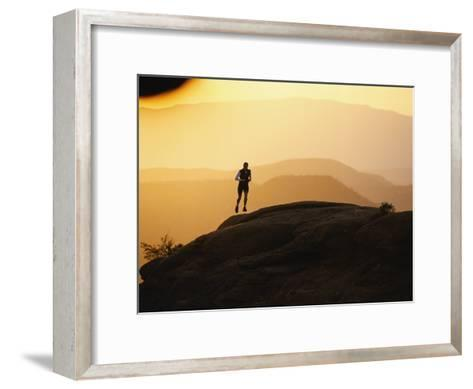 A Woman Runs on Red Rocks-Dugald Bremner-Framed Art Print