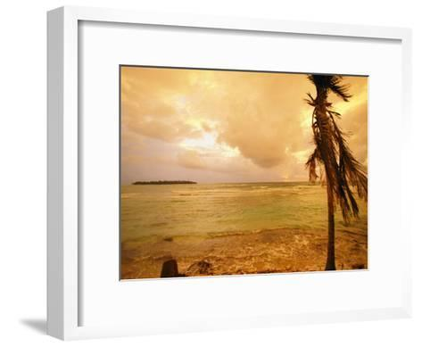 A Tropical Beach Scene with an Island in the Background-Kate Thompson-Framed Art Print