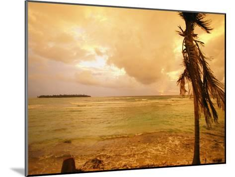 A Tropical Beach Scene with an Island in the Background-Kate Thompson-Mounted Photographic Print