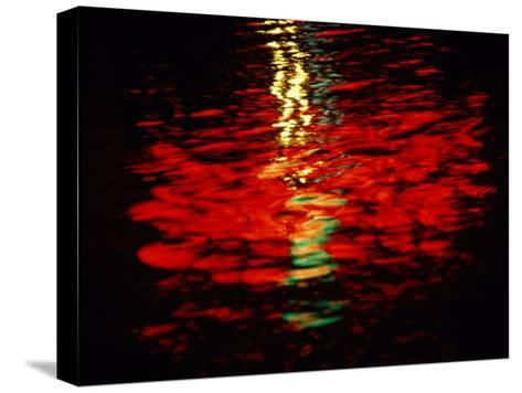 Light Reflected in the Water at Night-Raymond Gehman-Stretched Canvas Print