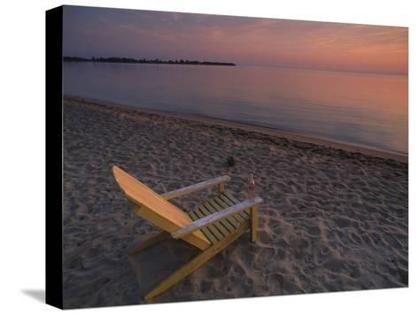 Beach Chair Facing the Water at Twilight-Bill Hatcher-Stretched Canvas Print