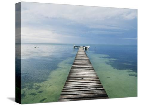 An Empty Dock Leads off into the Distance-Skip Brown-Stretched Canvas Print