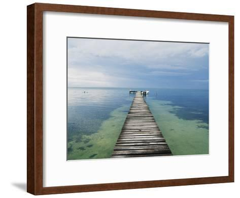 An Empty Dock Leads off into the Distance-Skip Brown-Framed Art Print
