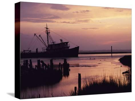 Fishing Boat Silhouetted at Twilight-Al Petteway-Stretched Canvas Print