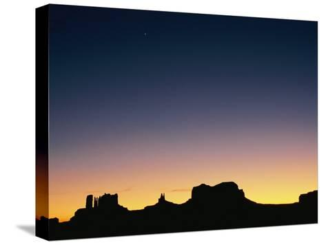 Sunset Silhouetting the Desert Landscape-Rich Reid-Stretched Canvas Print