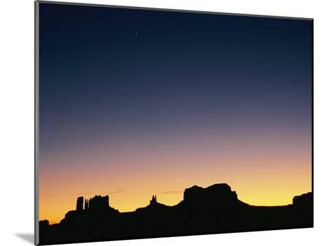 Sunset Silhouetting the Desert Landscape-Rich Reid-Mounted Photographic Print