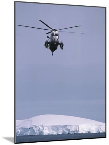 An Argentine Helicopter Flies over Anvers Island-Gordon Wiltsie-Mounted Photographic Print