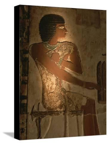 A Stone Relief Depicts a Member of Ancient Egyptian Royalty-Kenneth Garrett-Stretched Canvas Print