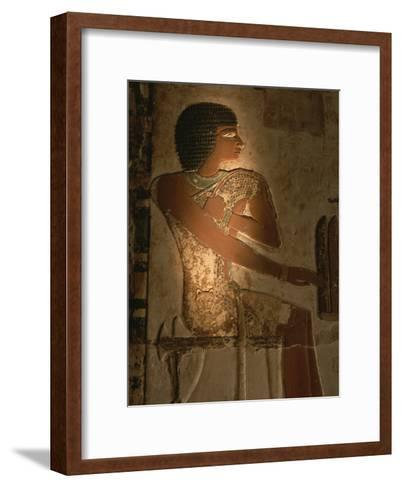 A Stone Relief Depicts a Member of Ancient Egyptian Royalty-Kenneth Garrett-Framed Art Print
