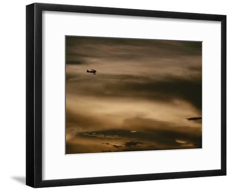 A Small Airplane Flies Through a Cloudy Sky over Key West, Florida-Raul Touzon-Framed Art Print