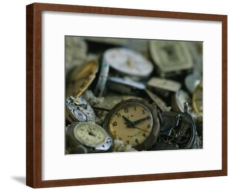 Old Watch Faces in Sand-Joel Sartore-Framed Art Print