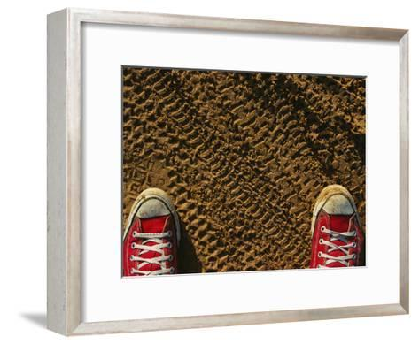 Red Sneakers on Soil Patterned with Tire Tracks-Joel Sartore-Framed Art Print