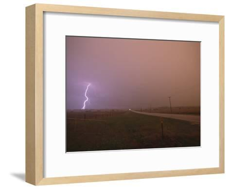 Cloud-To-Ground Lightning Strikes a Field and Brightens a Foggy Sky-Peter Carsten-Framed Art Print