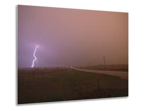 Cloud-To-Ground Lightning Strikes a Field and Brightens a Foggy Sky-Peter Carsten-Metal Print