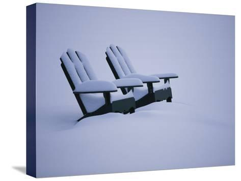 A Pair of Adirondack Chairs in the Snow-Michael Melford-Stretched Canvas Print