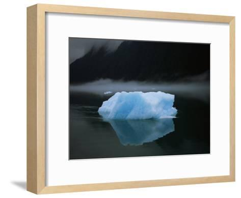 A Blue Iceberg and its Reflection in Calm Water-Ralph Lee Hopkins-Framed Art Print