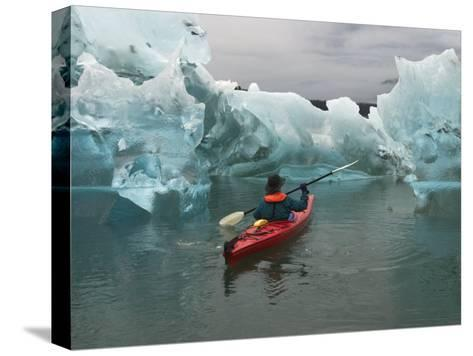 A Kayak Paddler Passes Sculpted Icebergs in Tracy Arm Fjord-Ralph Lee Hopkins-Stretched Canvas Print