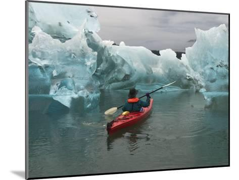 A Kayak Paddler Passes Sculpted Icebergs in Tracy Arm Fjord-Ralph Lee Hopkins-Mounted Photographic Print