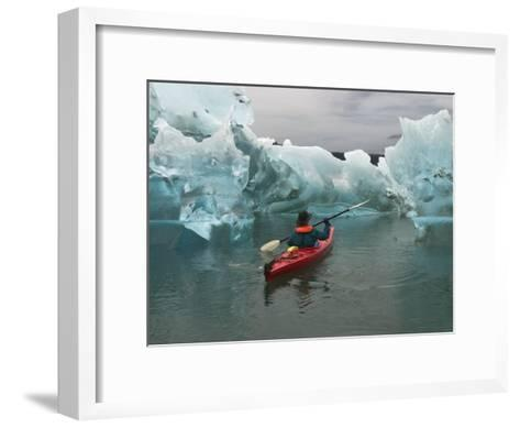 A Kayak Paddler Passes Sculpted Icebergs in Tracy Arm Fjord-Ralph Lee Hopkins-Framed Art Print