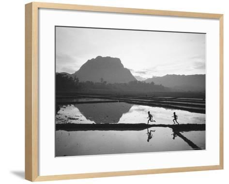 Boys Running Through Flooded Rice Paddy-John Dominis-Framed Art Print