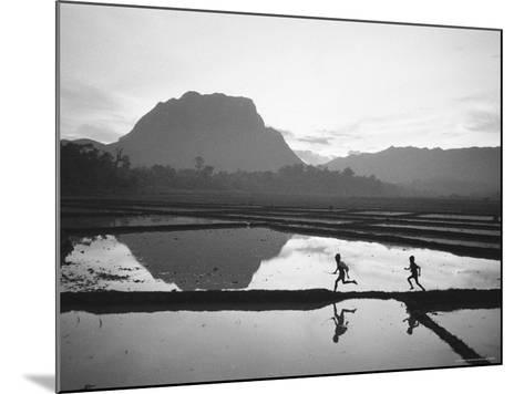 Boys Running Through Flooded Rice Paddy-John Dominis-Mounted Photographic Print