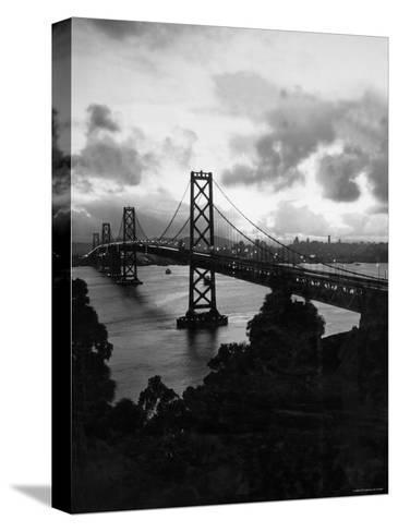 Atmospheric View of the San Francisco Oakland Bay Bridge Viewed from the Oakland Side at Dusk--Stretched Canvas Print